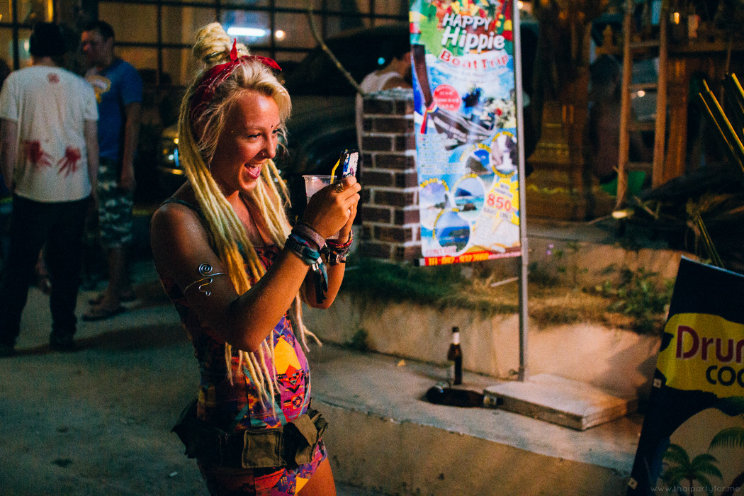 full moon party 15 february 2014: girl take photo on full moon party